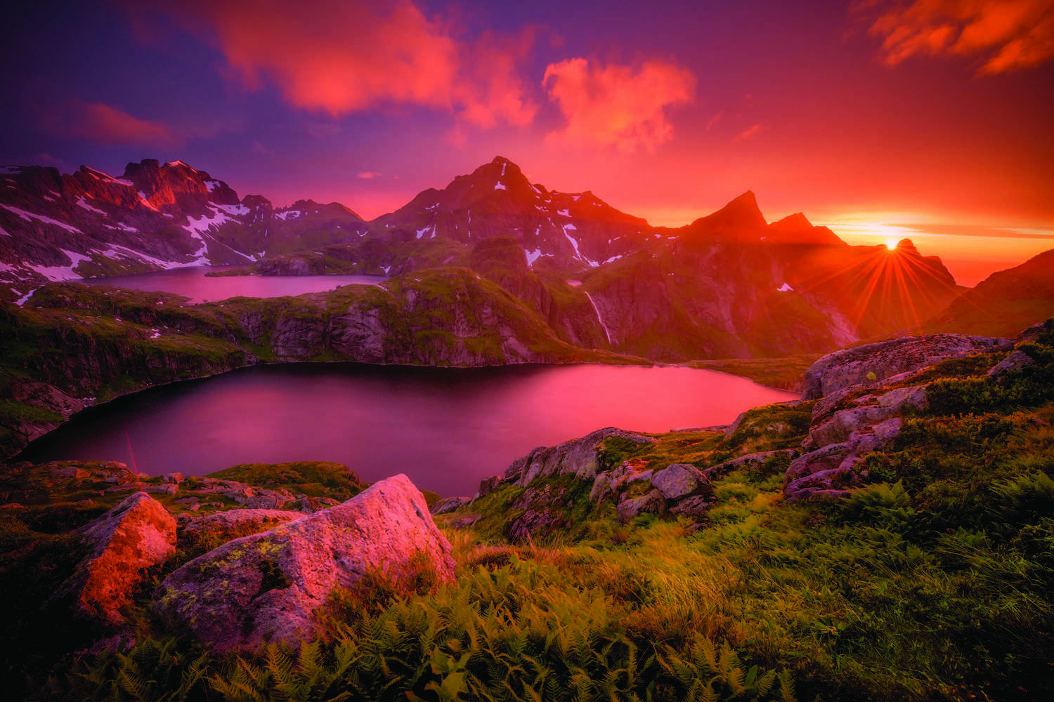 An amazing sunset over two lakes and a waterfall.